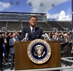 A picture of John Fitzgerald Kennedy speaking at Rice University in Houston about the Apollo Moon mission